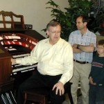 David Chamberlin and son look on as Mike lectures