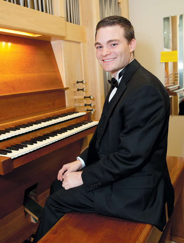 Tyler Boehmer sits at an organ on the BYU campus.  Boehmer is currently studying organ performance at the university.