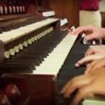 several-hands-at-organ