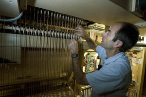 Paul Fraughton  |  The Salt Lake Tribune  David Chamberlin of Bigelow& Co. works inside the organ being installed at St. Marks Cathedral in Salt Lake City.   Tuesday, September 20, 2011